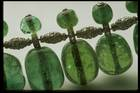 Close-up photograph of round emeralds in the India emerald necklace (NMNH G5023)