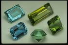 Photograph of green, blue, and yellow varieties of beryl from the National Gem Collection