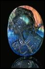 Close-up photograph of a carved labradorite head (NMNH G1750) from the National Gem Collection with mirror