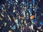 Micrograph of Shergotty meteorite (7498) under cross-polarized light at 1.25x magnification.