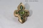 Cabochon-cut green zircon (43.79 ct) in a pendant.