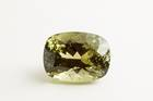 Rectangular cushion-cut greenish yellow apatite weighing 39.01 ct.