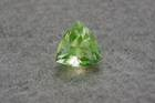 Trillion-cut yellowish green opal (var. hyalite) weighing 3.45 ct.