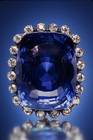 Logan Sapphire. Cushion mixed-cut medium blue corundum (var. sapphire) (423 ct) in a pendant. Lot described as