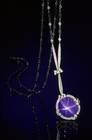 Oval cabochon-cut medium-to-light blue corundum (var. sapphire) (6 ct) in a necklace. Lot described as