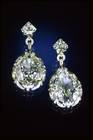 Marie Antoinette Diamond Earrings. Old mine pear-shaped-cut colorless diamond (14.25 ct) in earrings set in white and yellow metal with multiple round and modified triangular diamonds.