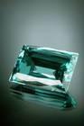 Rectangular mixed-cut light blue green beryl (var. aquamarine) weighing 1 ct.