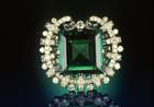Hooker Emerald. Square step-cut medium blue green beryl (var. emerald) (75.47 ct) in a brooch set in platinum with 109 colorless round brilliant diamonds (approx. 10 ct total wt) and 20 colorless baguette diamonds (approx. 3 ct total wt).