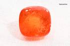 Square cabochon-cut orange spessartine weighing 19.77 ct.