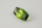 Modified barrel-cut green forsterite (var. peridot) weighing 46.16 ct.
