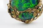 Tiffany Opal Necklace. Modified pear-shaped cabochon-cut black opal in a pendant, necklace. Lot described as