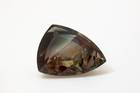Modified shield-cut labradorite sunstone weighing 67.5 ct, faceted by Darryl Alexander and Aivan Pham.