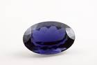 Oval-cut dark blue cordierite weighing 63.83 ct.