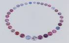 This suite of 32 round cut spinels from Vietnam is a major upgrade for the National Gem Collection and represents the range of available colors, from lilac to purple to blue and pink to peach and orange, from this locality.
