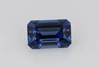 All tanzanite gemstones originate from the area where they were initially discovered in Tanzania. This unusual emerald-cut tanzanite gem, faceted by Paul Merkel, weighs 18.56ct and is a deep blue color with flashes of purple.