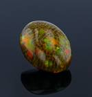 This 75 carat opal is a very unique specimen as it is large in size, has a brown body color, good play-of-color, and exhibits a finger-like structure called a digit pattern (vertical columnar structure), making it a wonderful upgrade for the National Gem Collection.