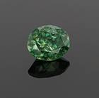 The rarest and most valuable garnet gem is the green to yellowish-green variety of the mineral andradite, called demantoid. This 6.96ct oval cut demantoid is from the Green Dragon Mine in Namibia.