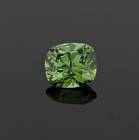 The rarest and most valuable garnet gem is the green to yellowish-green variety of the mineral andradite, called demantoid. This 3.00ct cushion cut demantoid is from the Green Dragon Mine in Namibia.