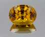 This deeply saturated heliodor is a natural orange-yellow color and weighs 147.23ct. The yellow glow of heliodor is due to impurities of iron.