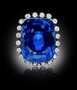 Logan Sapphire. A cushion-mixed-cut, medium-blue sapphire pendant. Described as