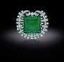Hooker Emerald. A brooch featuring square-step-cut, medium-blue-green emerald. Described as