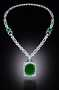 Mackay Emerald Necklace. A necklace featuring modified-oval-brilliant-cut, medium-blue-green emerald. Described as
