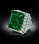Chalk Emerald. A ring featuring rectangular-step-cut, med-dark-slightly-blue-green emerald. Described as