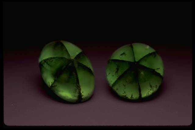 Photograph of two trapiche emeralds (NMNH G9127 and G9120)
