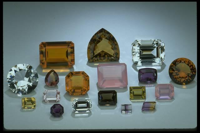 Photograph of a large group of faceted quartz gems from the National Gem Collection