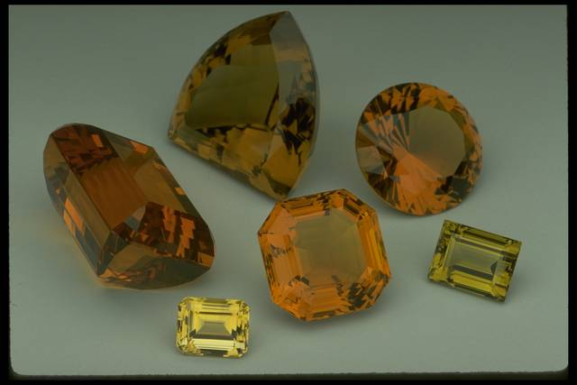Photograph of six citrines (NMNH G3732, G7721, G3640, G2041, G9015, and G2269) from the National Gem Collection