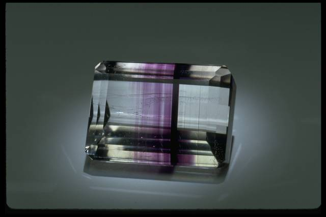 Photograph of a rectangular banded amethyst/clear quartz (NMNH G8143) from the National Gem Collection