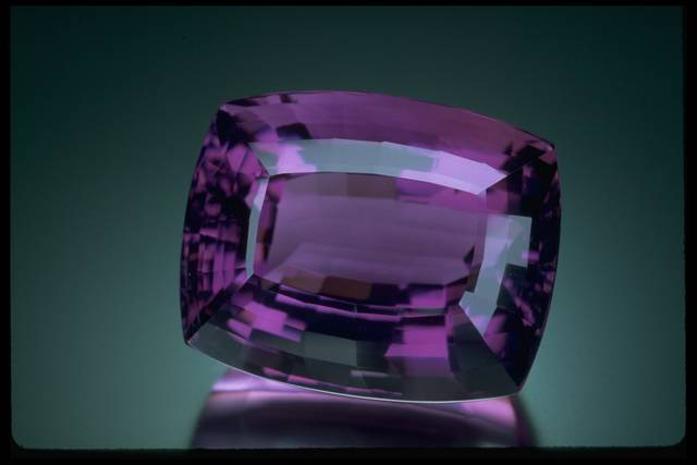 Photograph of a large cushion-cut amethyst (NMNH G9575) from the National Gem Collection