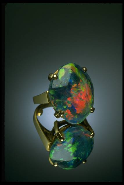 Photograph of a black opal ring (NMNH G4664) from the National Gem Collection