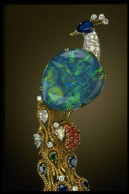 Close-up photograph of the opal peacock brooch (NMNH G7987)