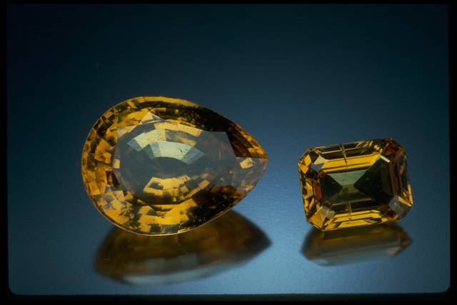 Photograph of one square (NMNH G2246) and one pear-shaped (G10068) grossular garnet from the National Gem Collection