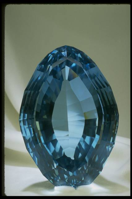 Photograph of a football-shaped blue topaz (NMNH G8990) from the National Gem Collection