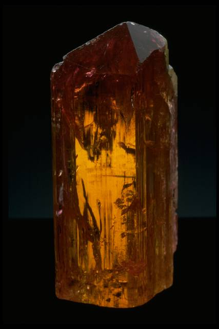 Photograph of the uncut Impreial topaz (116879) from the National Mineral Collection