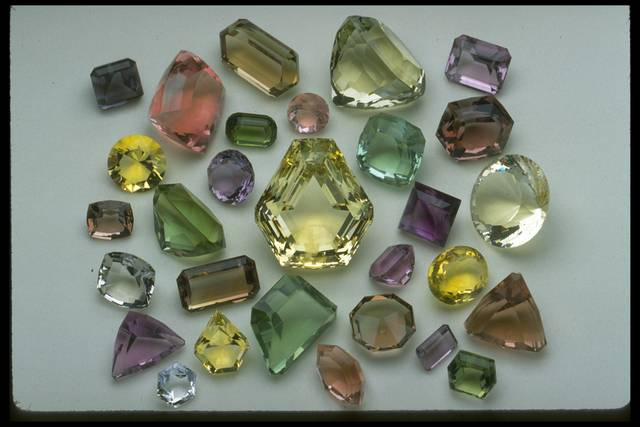 Photograph of a group of fluorites from the National Gem Collection showing a range of colors