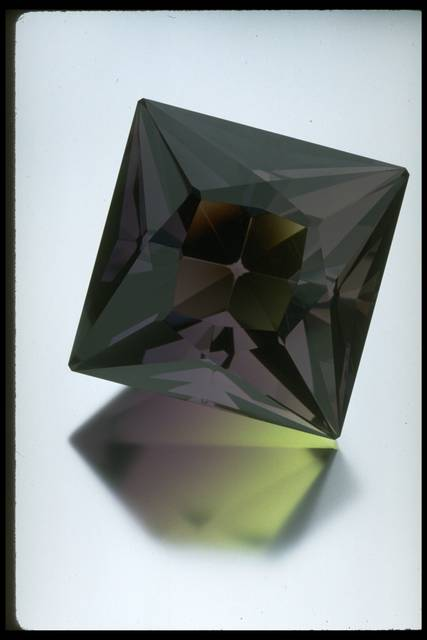 Photograph of a large faceted fluorite octahedron (NMNH G10031) from the National Gem Collection