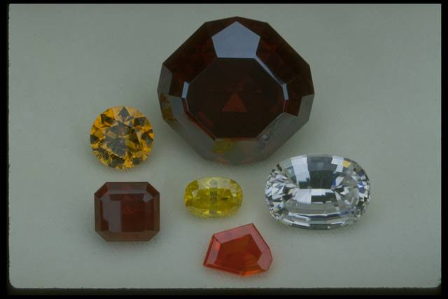 Photograph of a group of rare and unusual gems (NMNH G3803, G8122, G3386, G4917, G8636, and G9973) from the National Gem Collection