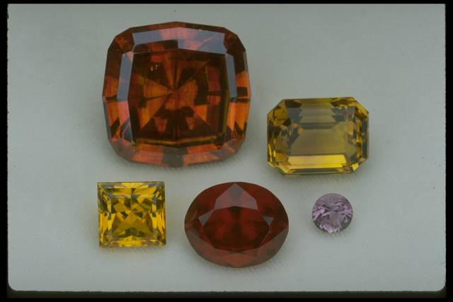 Photograph of a group of rare and unusual gems (NMNH G9018, G8633, G9837, G8454, and G8419) from the National Gem Collection
