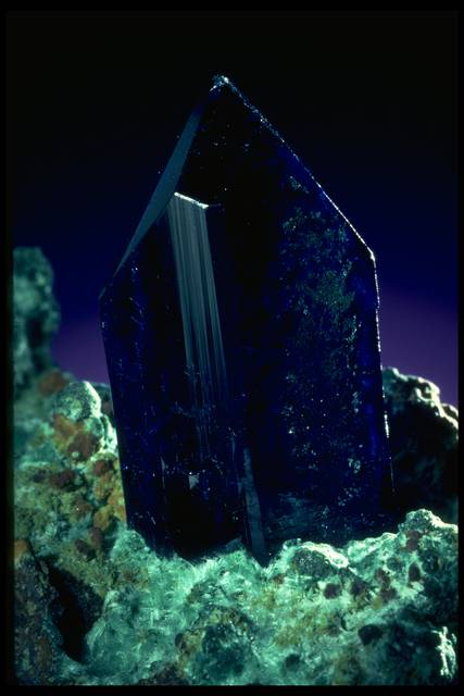 Photograph of an azurite crystal in malachite (104885) from the National Mineral Collection