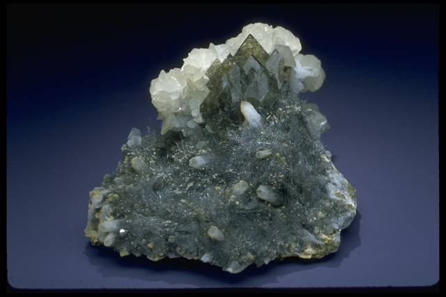 Photograph of barite with berthierite, calcite, and quartz (NMNH R17491) from the National Mineral Collection