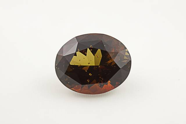 Dravite (NMNH G10697-00) from the National Gem Collection.