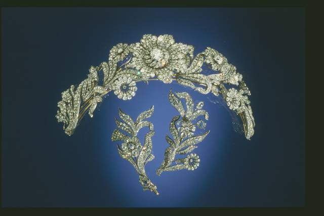 Post Diamond Tiara. Various old cuts (old mine, rose)-cut colorless diamond in a tiara, brooch.