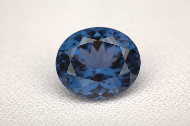 Oval-cut blue spinel weighing 14.02 ct.