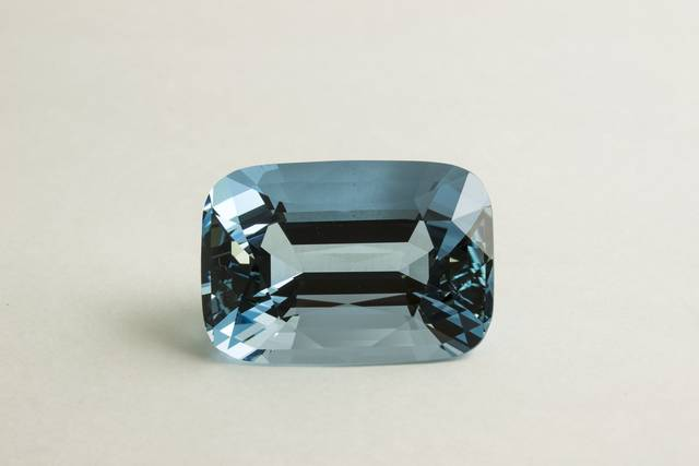 Rectangular cushion-cut light blue beryl (var. aquamarine) weighing 65.44 ct.