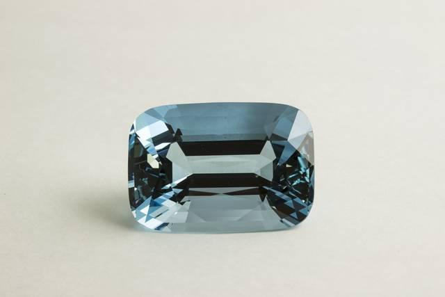 Rectangular cushion-cut light blue beryl (var. aquamarine) weighing 65.44 ct.