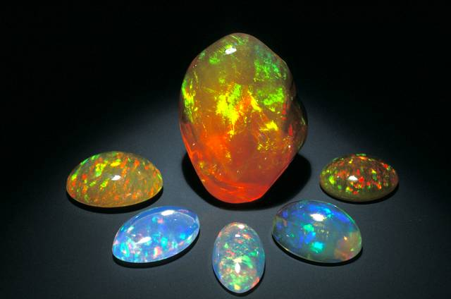 Photograph of six Mexican fire opals (NMNH G3968, G3886, G2111, G3964, G1072, and G2028) from the National Gem Collection