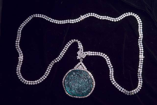 Mogul Emerald Necklace. Carved beryl (var. emerald) in a necklace. Lot described as